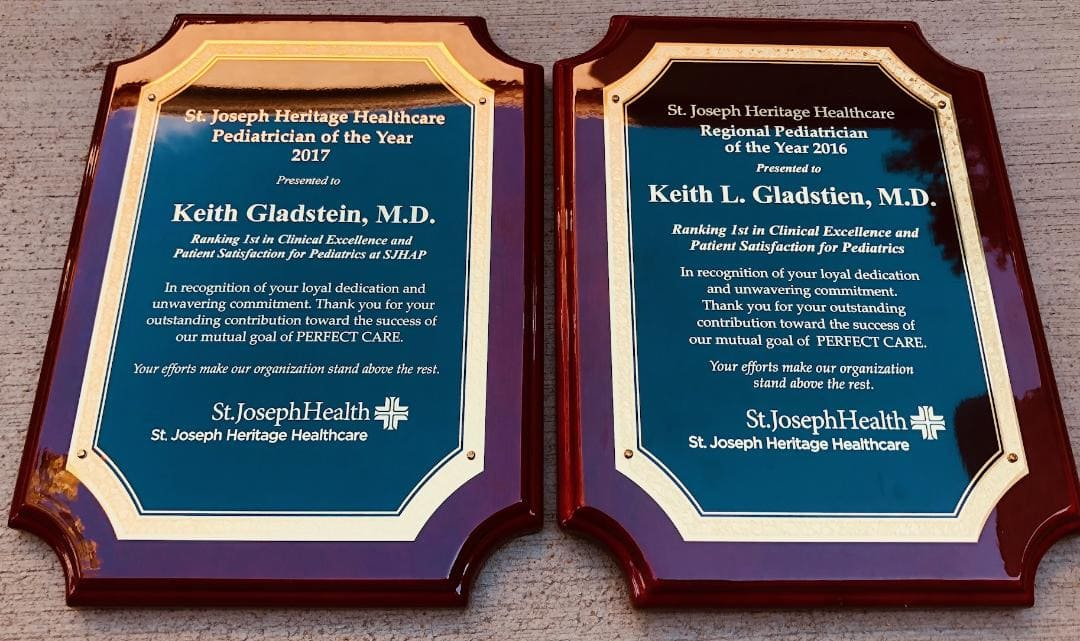 Best Pediatrician Award: Picture of 2 Plaques Celebrating Dr. Gladstien winning in back to back years