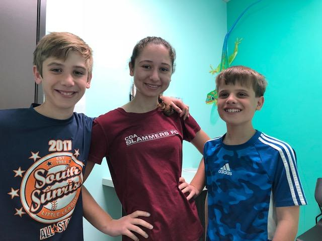 Sports Physicals: Picture of three young athletes