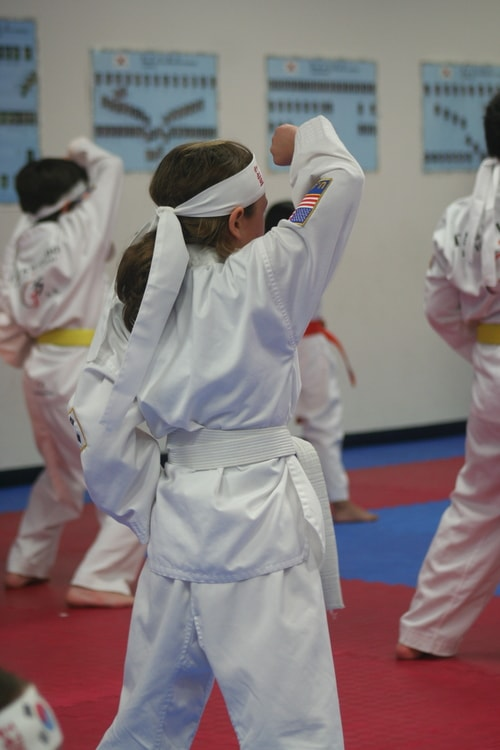 Martial Arts: picture of young girl doing tae kwan do forms